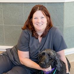 Vickie with her labradoodle in the clinic.