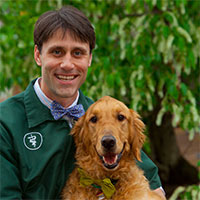 Dr Seth Lipstock and his golden retriever outside of the vet in Richmond, Virginia